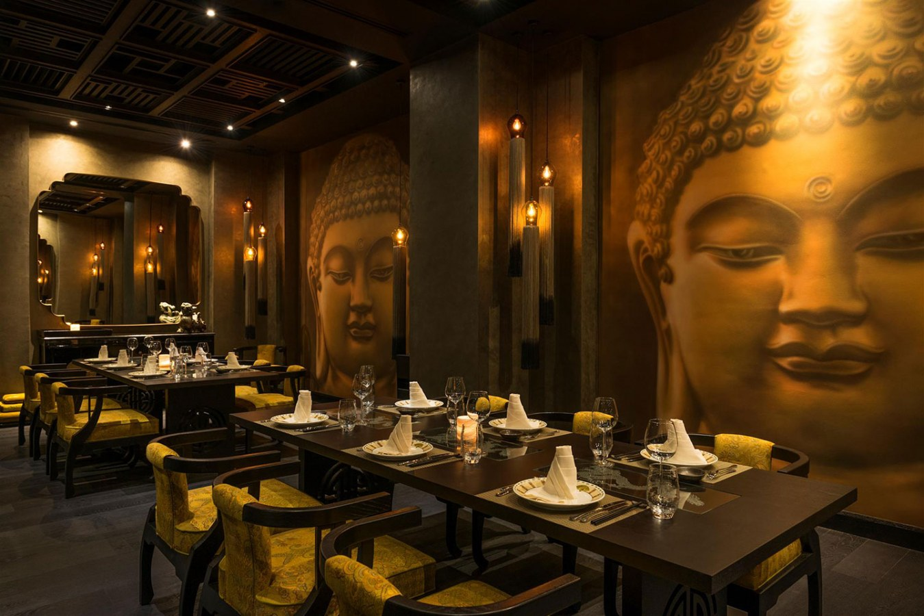The perfectly set tables at Buddha Bar Dubai with Buddha motifs on the walls everywhere