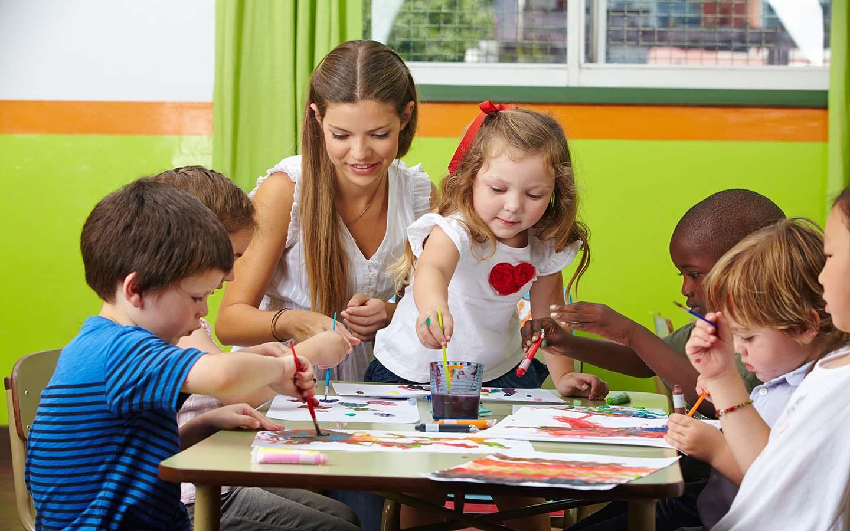 Kids painting in a nursery