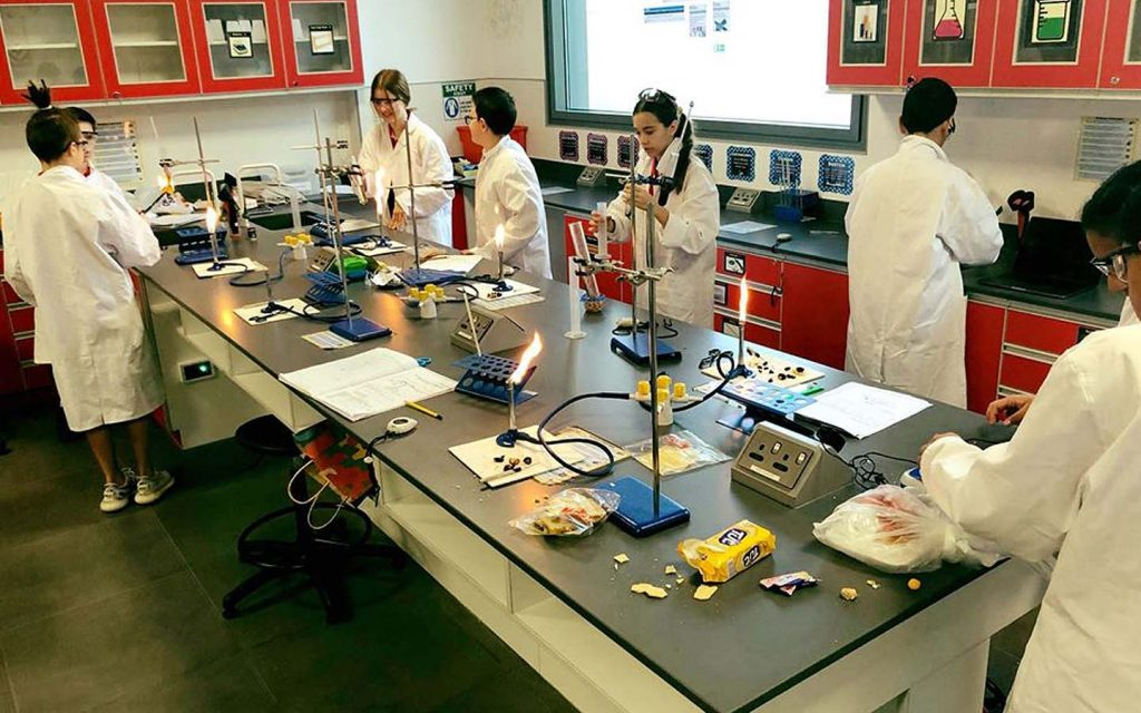 children performing a practical at a science lab