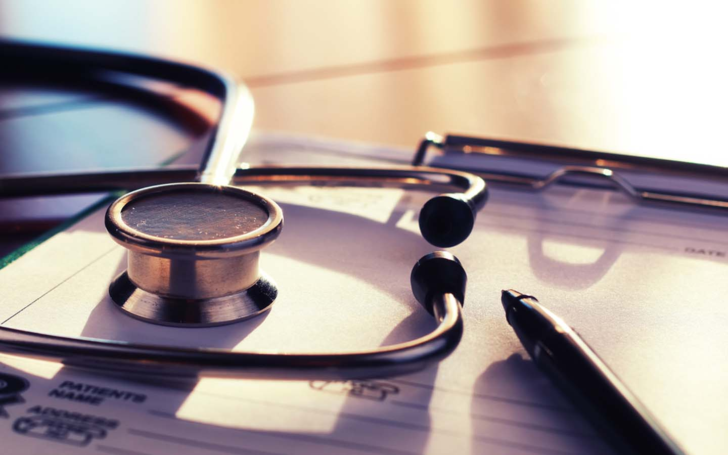 Stethoscope and health insurance documents