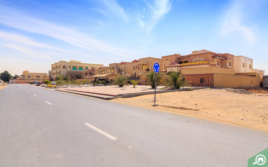 A street of spacious homes in Ajman. Affordability is what causes many to consider buying a villa in Ajman.