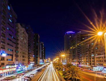 A busy Al Rashidiya road at night