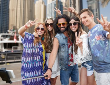 friends posing for a selfie when trying new things to do in Dubai