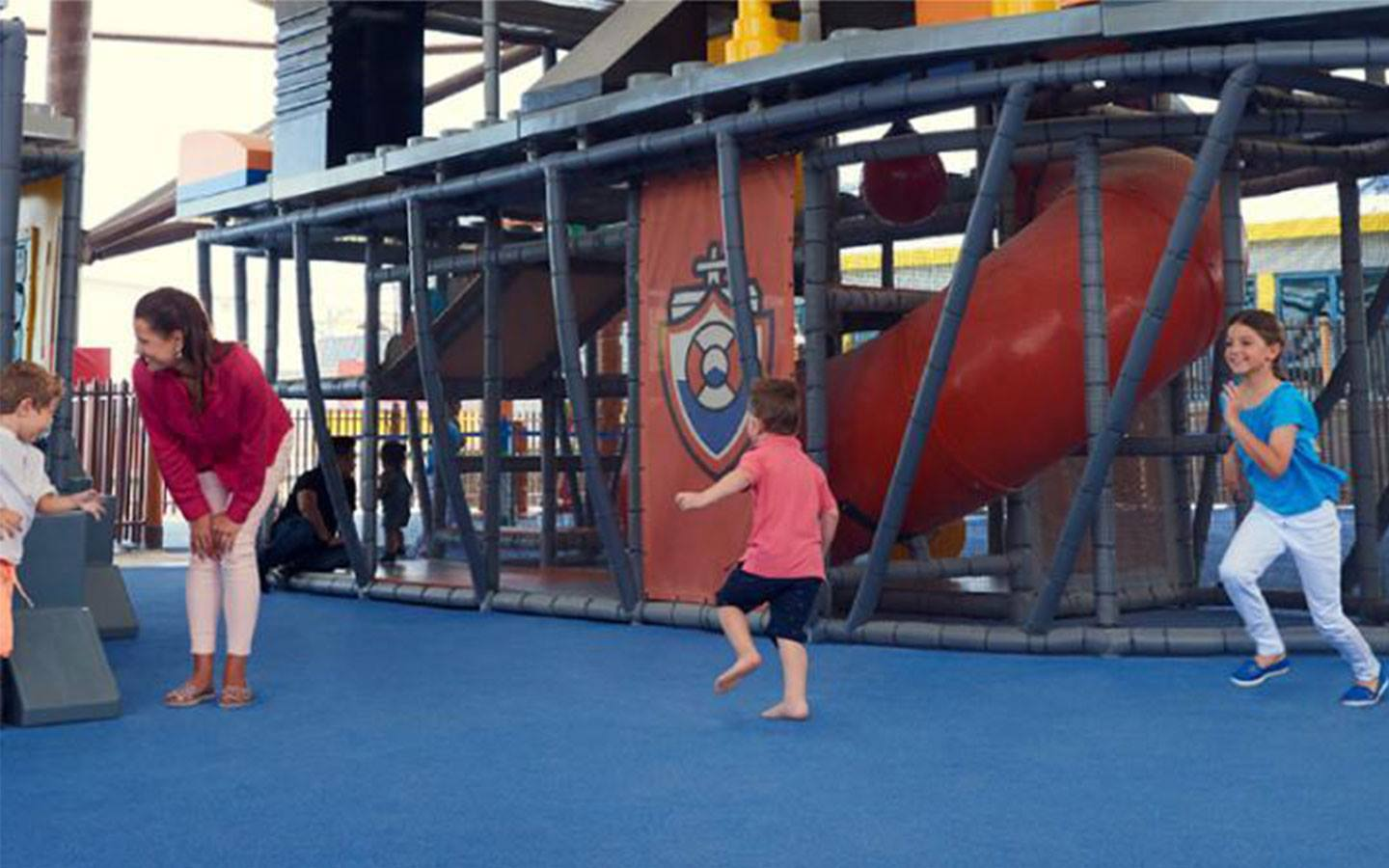 Children enjoying the thrills of LEGO-themed ships at Sea Port