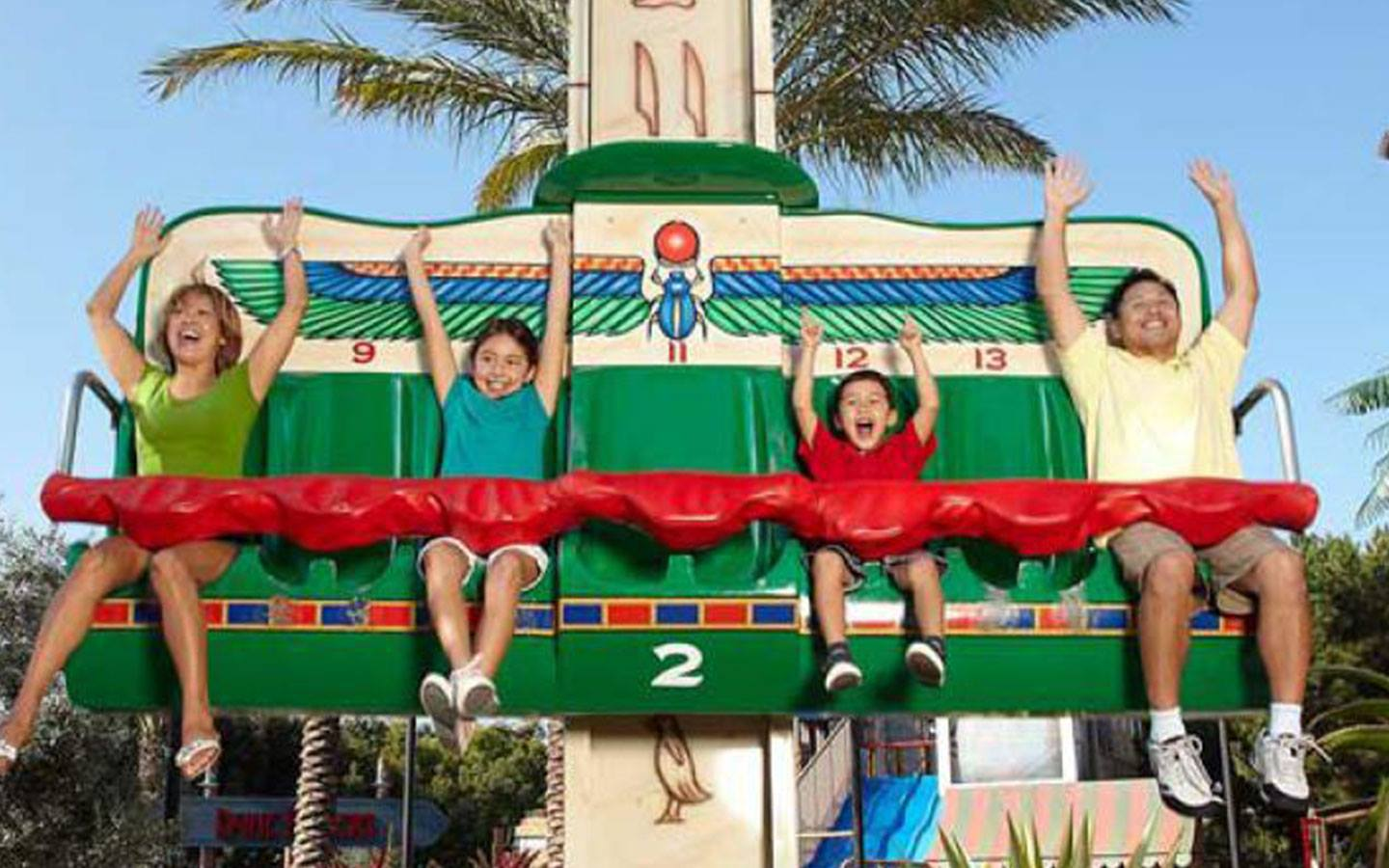Children are taking a ride with their parents at Legoland Dubai