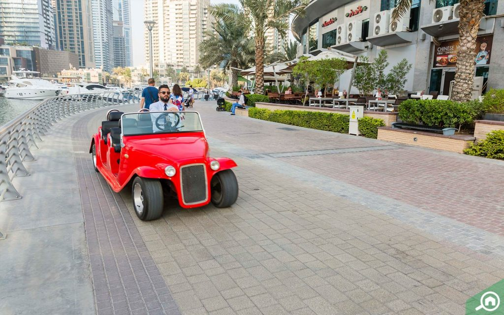 Worker driving a red vehicle in Marina Walk