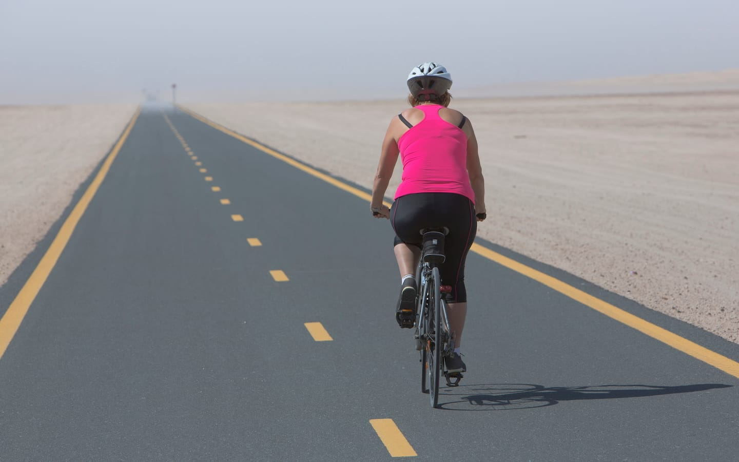 Cycling at Al Wathba Track is one of the fun things to do in Abu Dhabi at night.