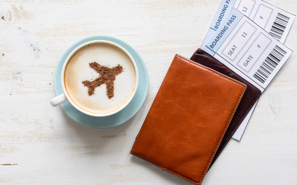 Coffee cup and boarding passes