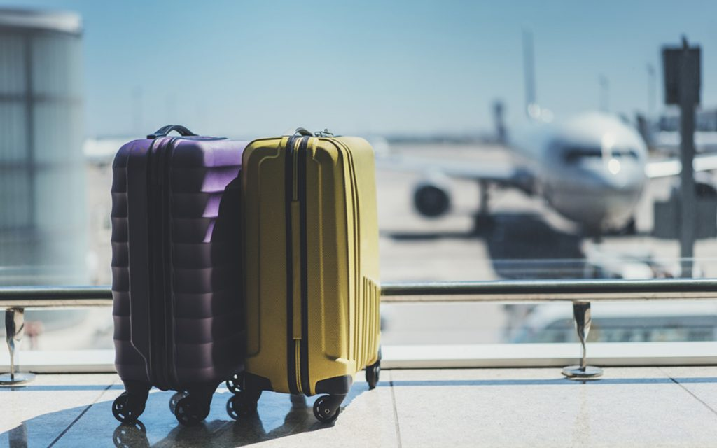 a pair of luggage at airport