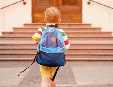 A student walking towards one of the cheap schools in Dubai