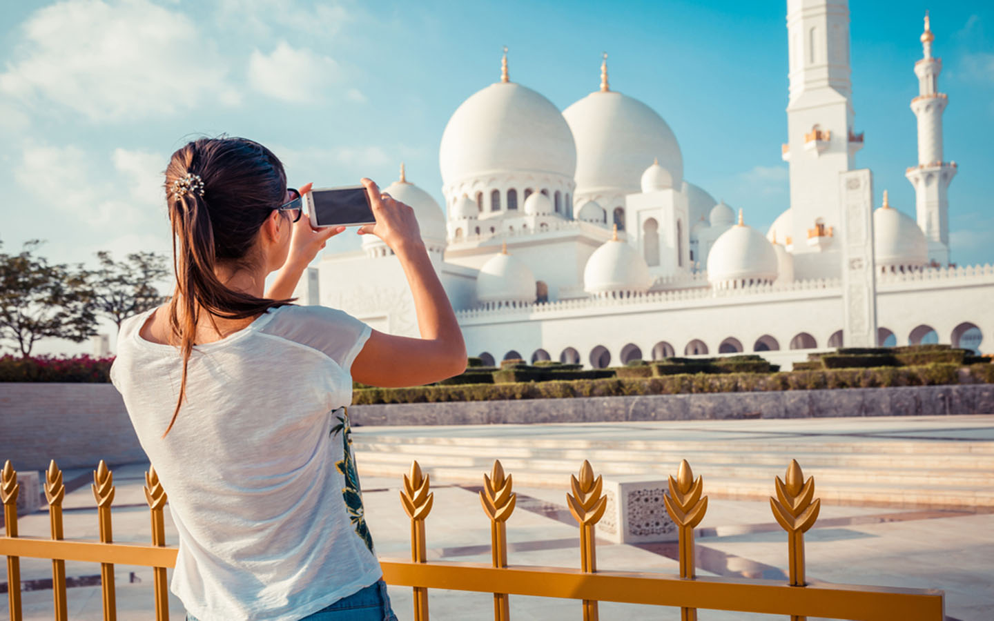 A tourist taking a picture in Sheikh Zayed Grand Mosque
