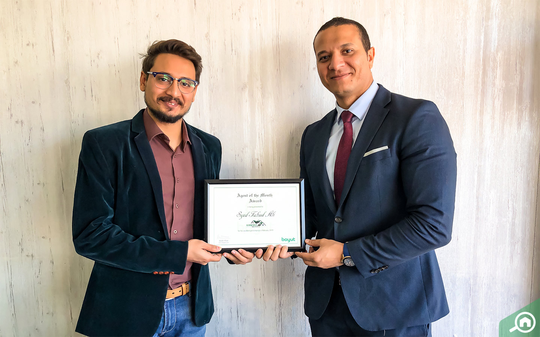 Real estate agent Syed Fahad Ali accepts award