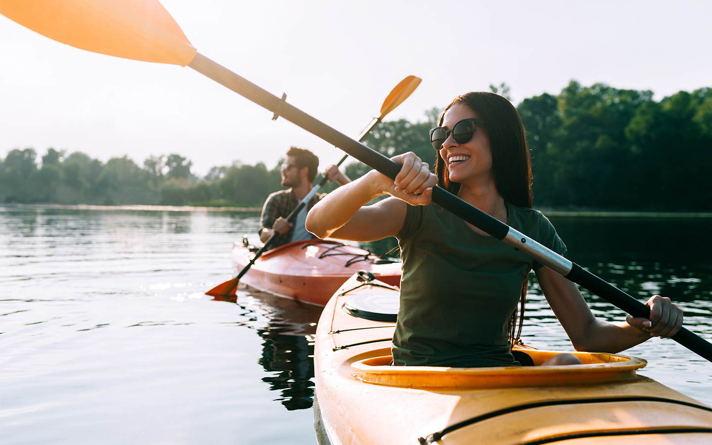 View of two people kayaking, one of the outdoor things to do in Abu Dhabi