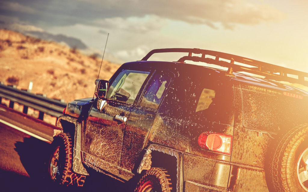 A muddy jeep after an off road tour
