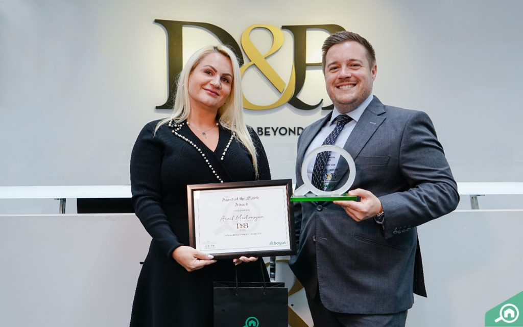 Anait Martirosyan, Client Manager at D&B Properties, receives Agent of the Month award from Gareth Davies