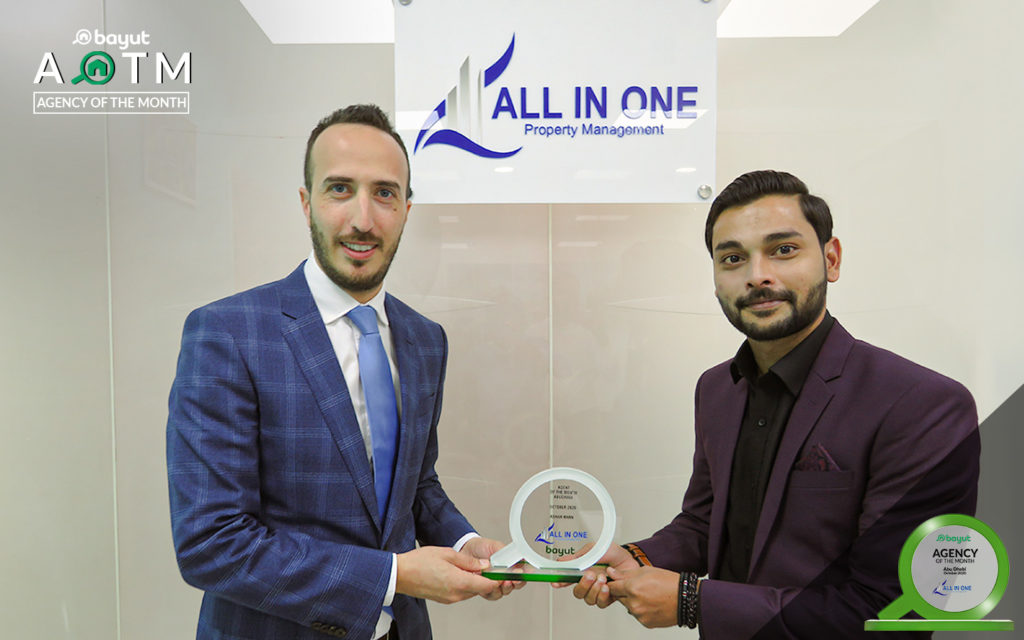 Mr Ashar Khan receiving Agent of the Month award