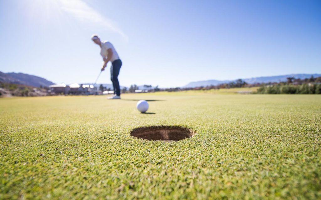 Man playing golf at Al Ain Equestrian , Shooting & Golf Club