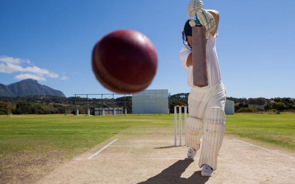 Batsman hitting a shot at a cricket oval at Al Ain Cricket Club