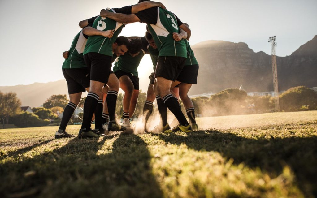 Men playing Rugby at Al Ain Rugby Club