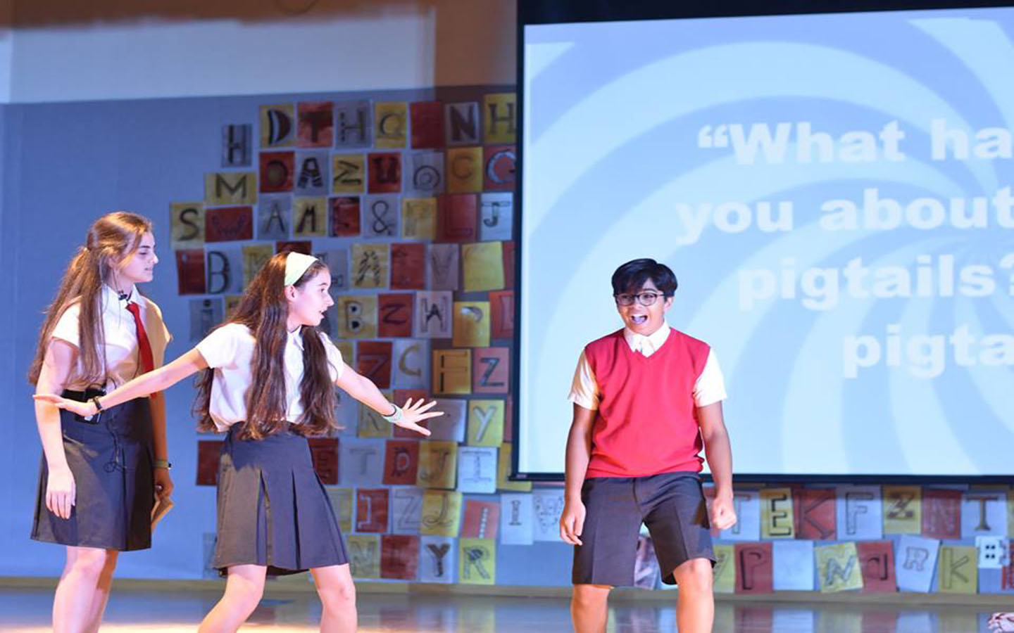 Students participating in a play at Al Bateen