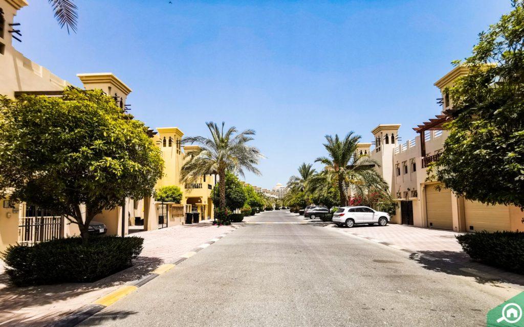 Street view of Al Hamra Village villas for sale