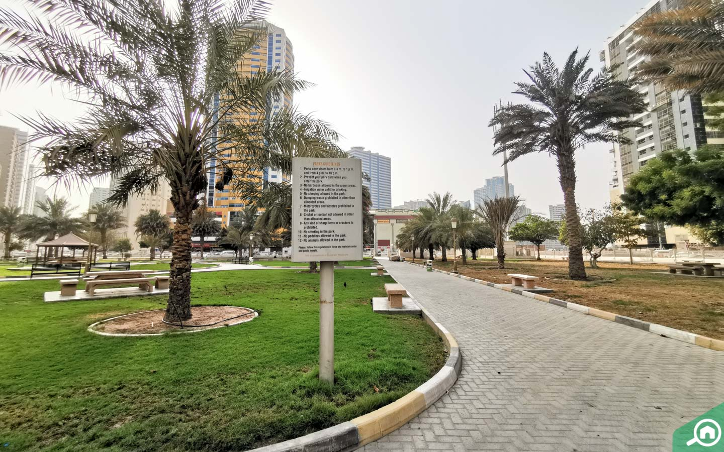 Information board in Al Nahda Park with rules and regulations