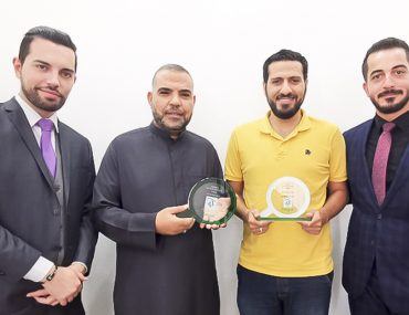 Members of Al Osool Real Estate, receiving the Bayut Agency of the Month award