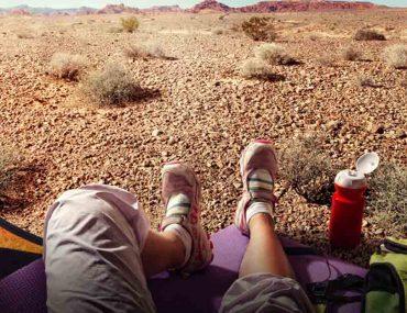 guy camping in the desert