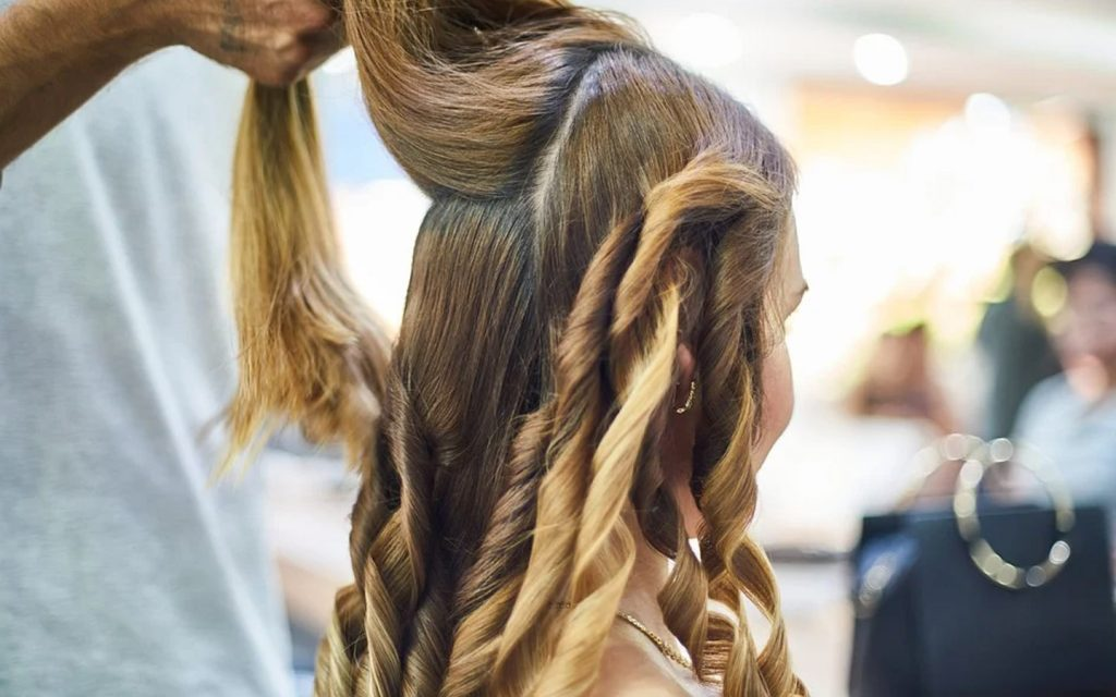 Woman getting a new hair style at a beauty salon