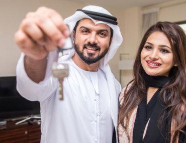Emirati family with house key