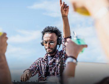 DJ Playing music at White Beach Dubai