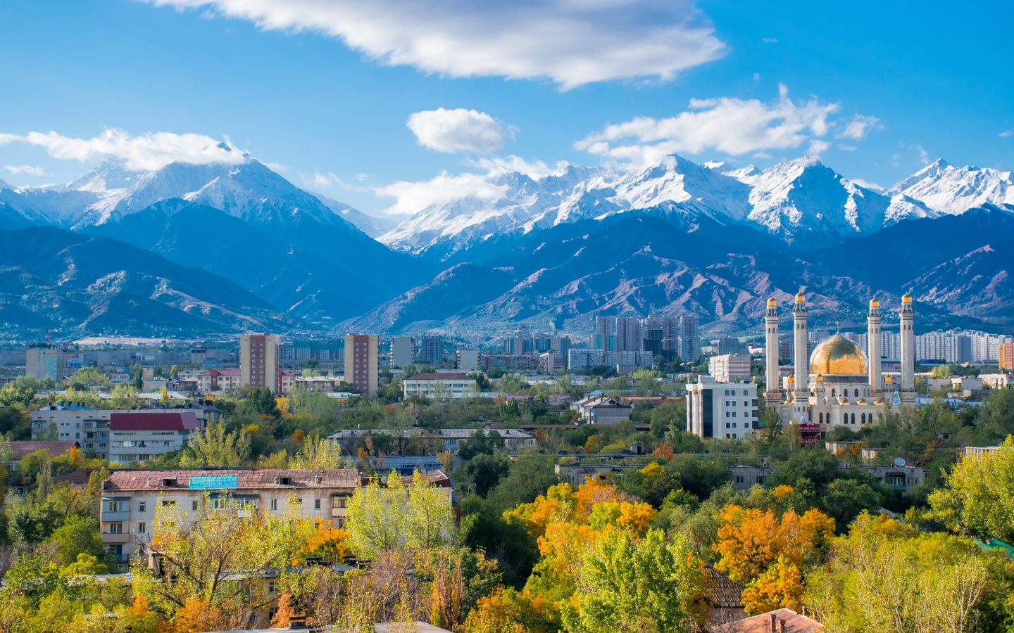 View of Almaty city and snow-capped mountains