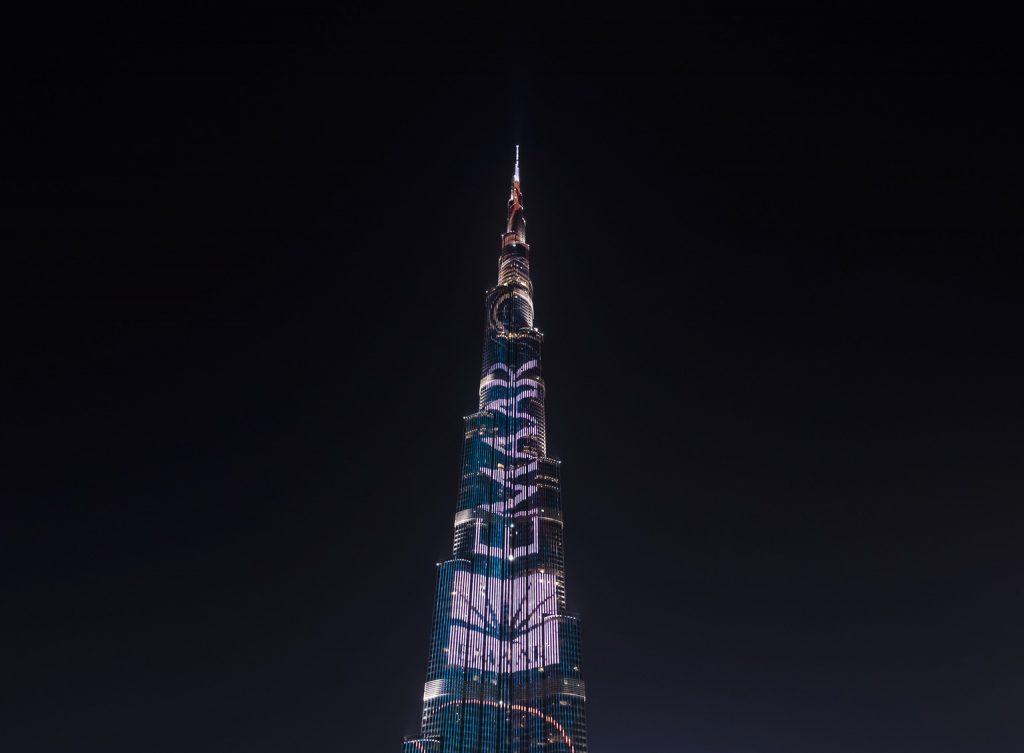 Burj Khalifa, Dubai with the words Emaar and Emaar's logo projected on it