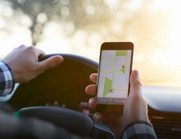 Man using an app while driving in Dubai