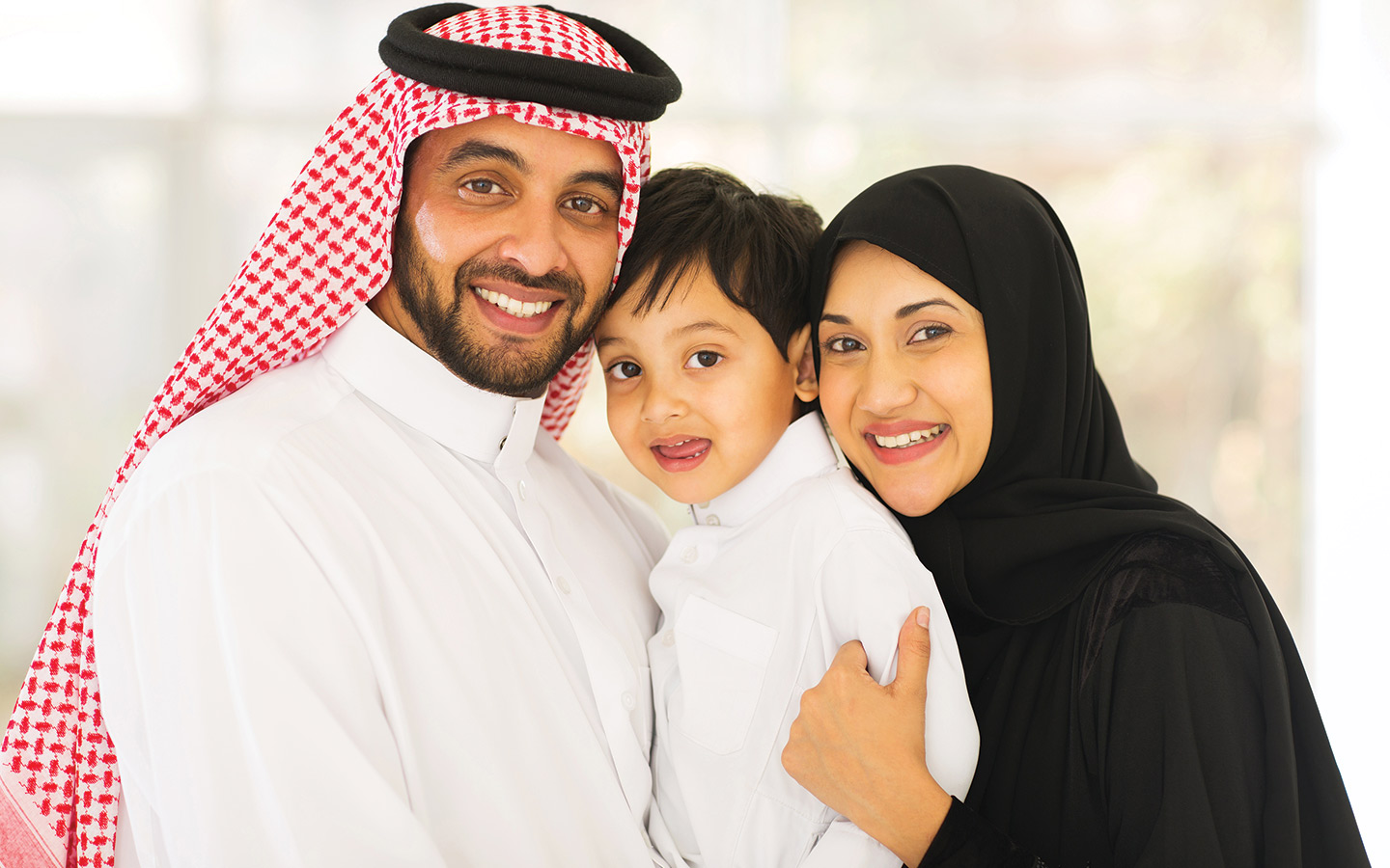 Arab family smiling and happy