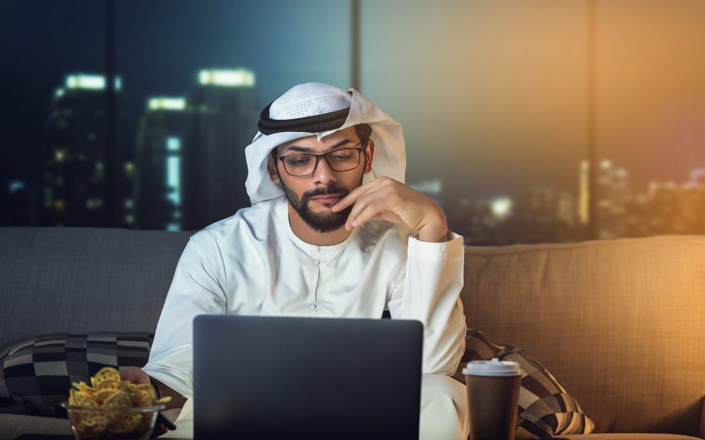 Arab man working remotely