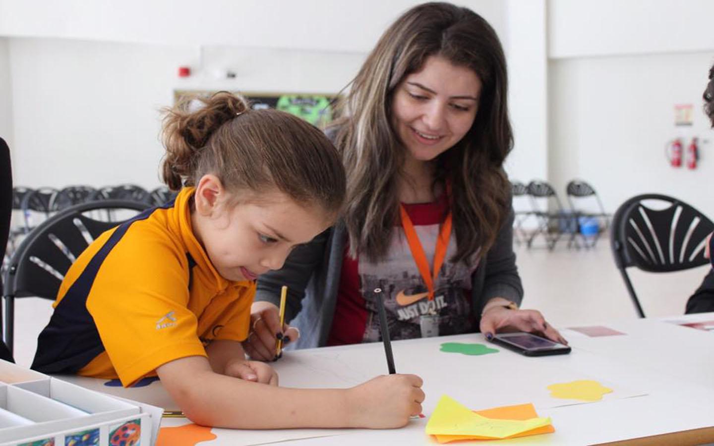Teacher while guiding a student at Aspen, Abu Dhabi