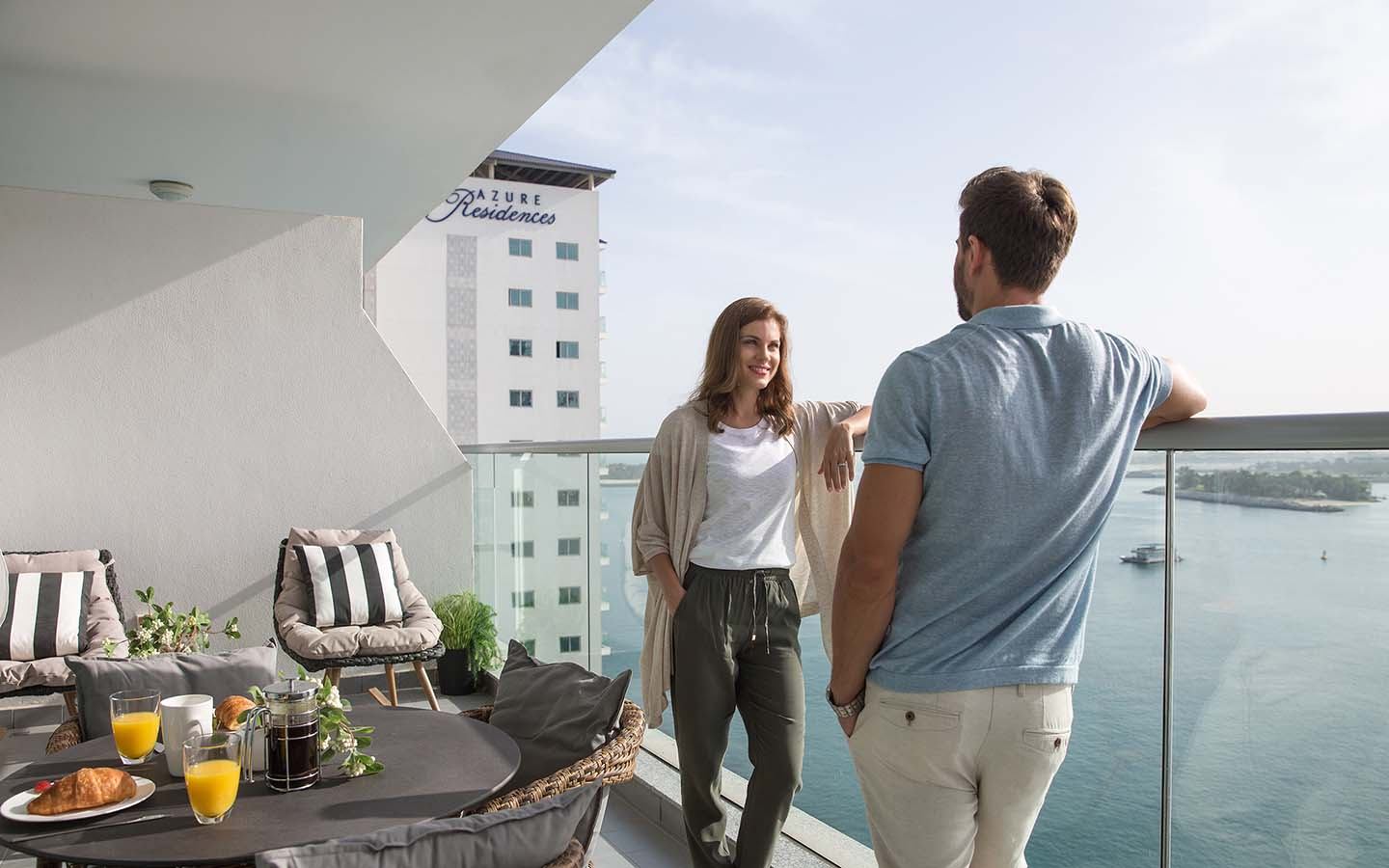 Couple on a terrace in an Azure Residences apartment