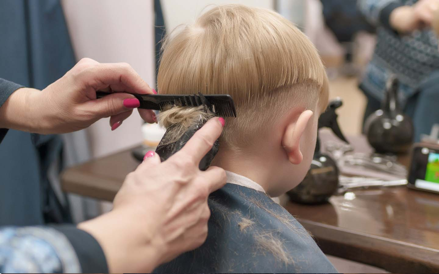 Baby boy hair cutting in one of the salons in Dubai
