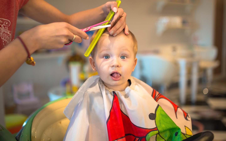 Baby boy hair cutting taking place in a kids salon in Dubai