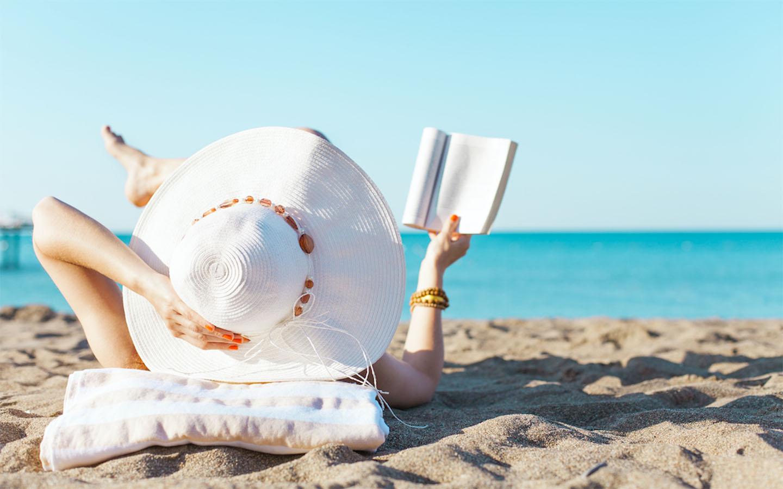 Woman reading a book on Dubai beaches