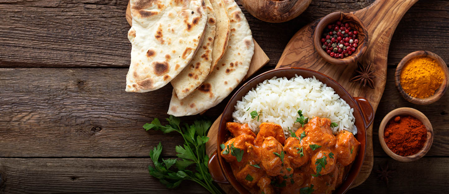 Indian curry with rice and flat bread