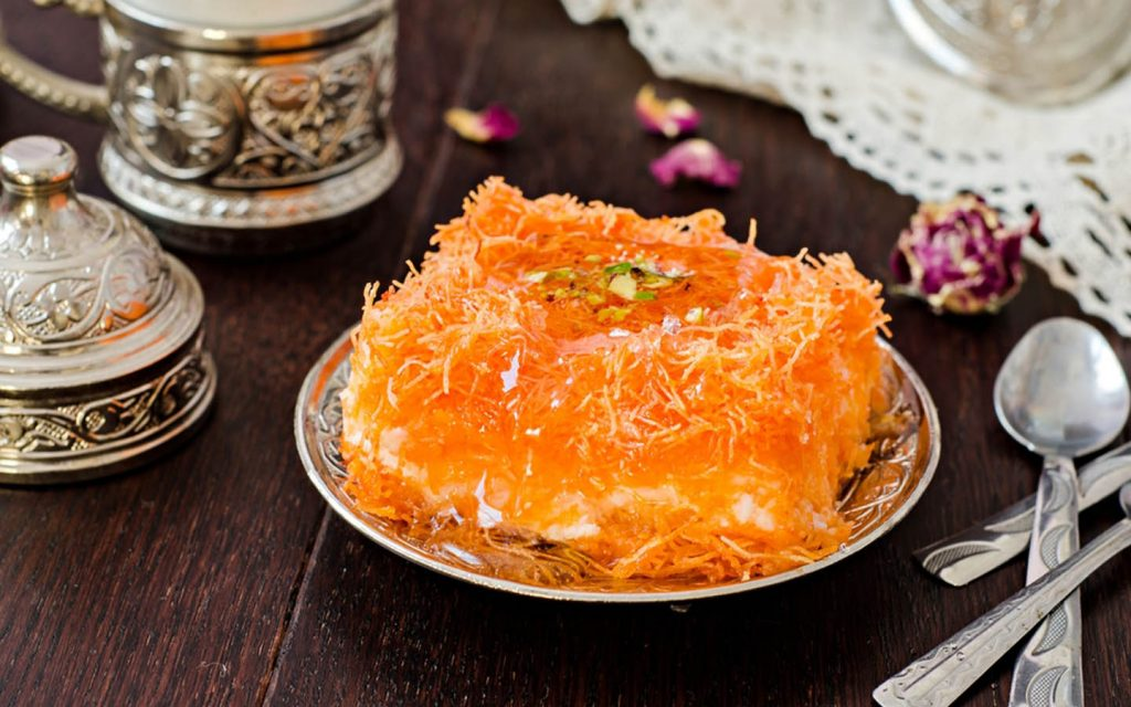 Kunafa served in traditional Arab silver plate