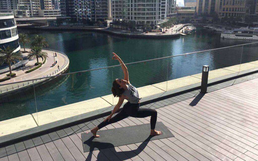 Woman at a yoga class in Dubai Marina
