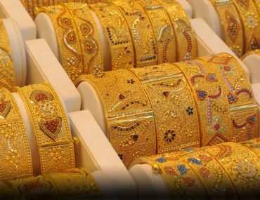 Gold bangles under a display case in the uae