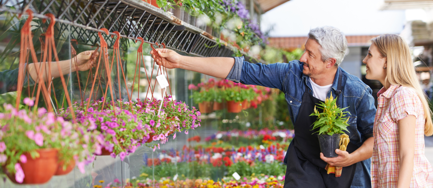 A person buying items from one of the best nurseries to buy plants in Dubai