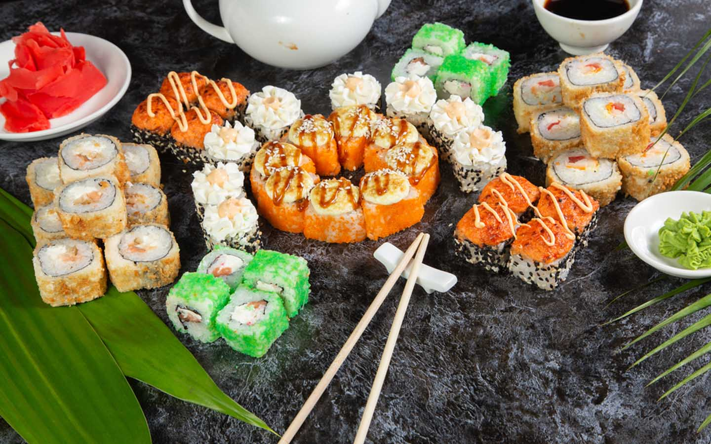 Wide platter of sushi and rolls