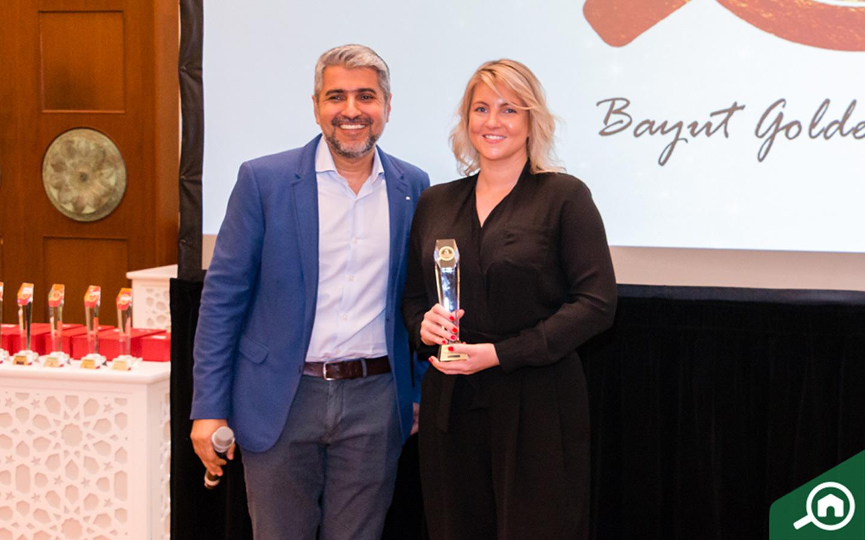 Better Homes LLC receiving the Golden Circle award at the Bayut Iftar