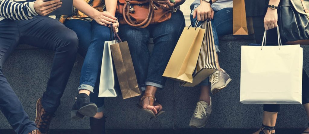 People with shopping bags from Bin Sougat Centre