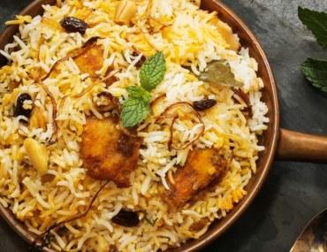 Biryani and raita being served at an Indian restaurant in Sharjah